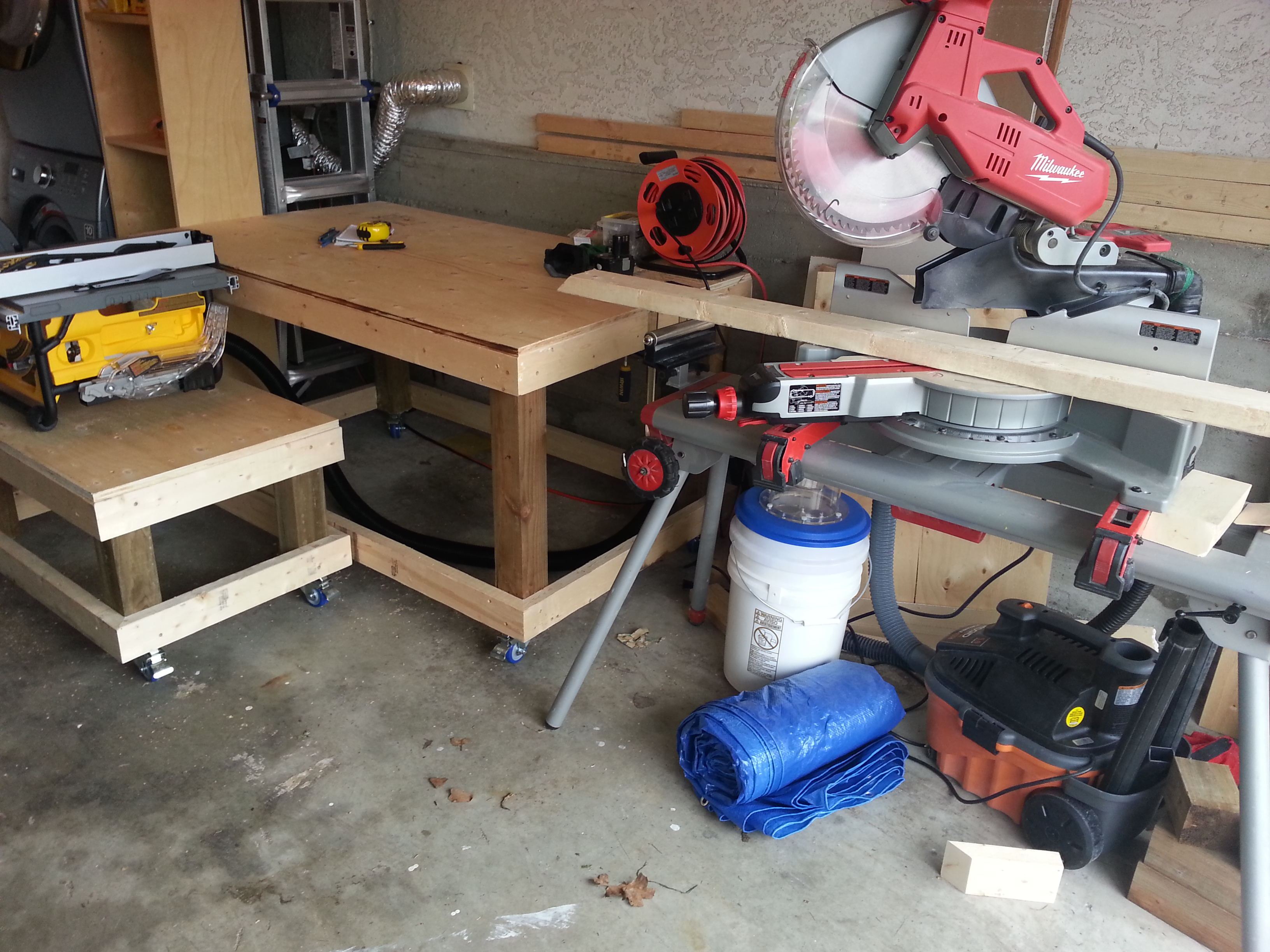I made the work benches with casters on them so I can pull them out and position them for better space.